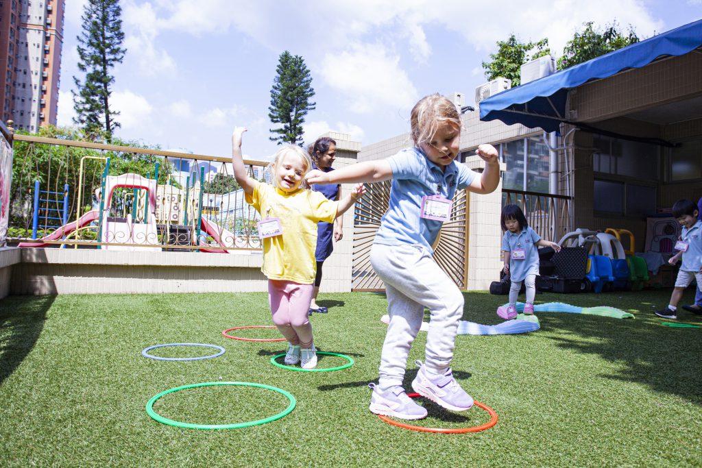 Toddler girls dancing outside at David Exodus Kindergarten