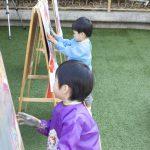 Kindergarten Kids drawing on aisle outdoor